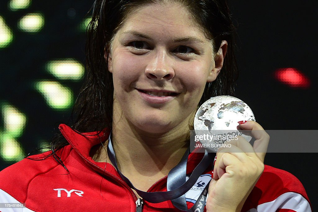 Silver medalist Denmark's <a gi-track='captionPersonalityLinkClicked' href=/galleries/search?phrase=Lotte+Friis&family=editorial&specificpeople=3035975 ng-click='$event.stopPropagation()'>Lotte Friis</a> poses with her medal on the podium during the award ceremony of the women's 800-metre freestyle swimming event in the FINA World Championships at Palau Sant Jordi in Barcelona on August 3, 2013.