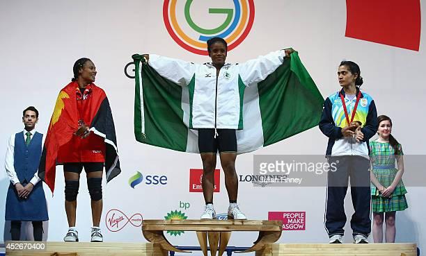 Silver medalist Dika Toua of Papa New Guinea Gold medalist Chika Amalaha of Nigeria and Bronze medalist Santoshi Matsu of India after the Women's...