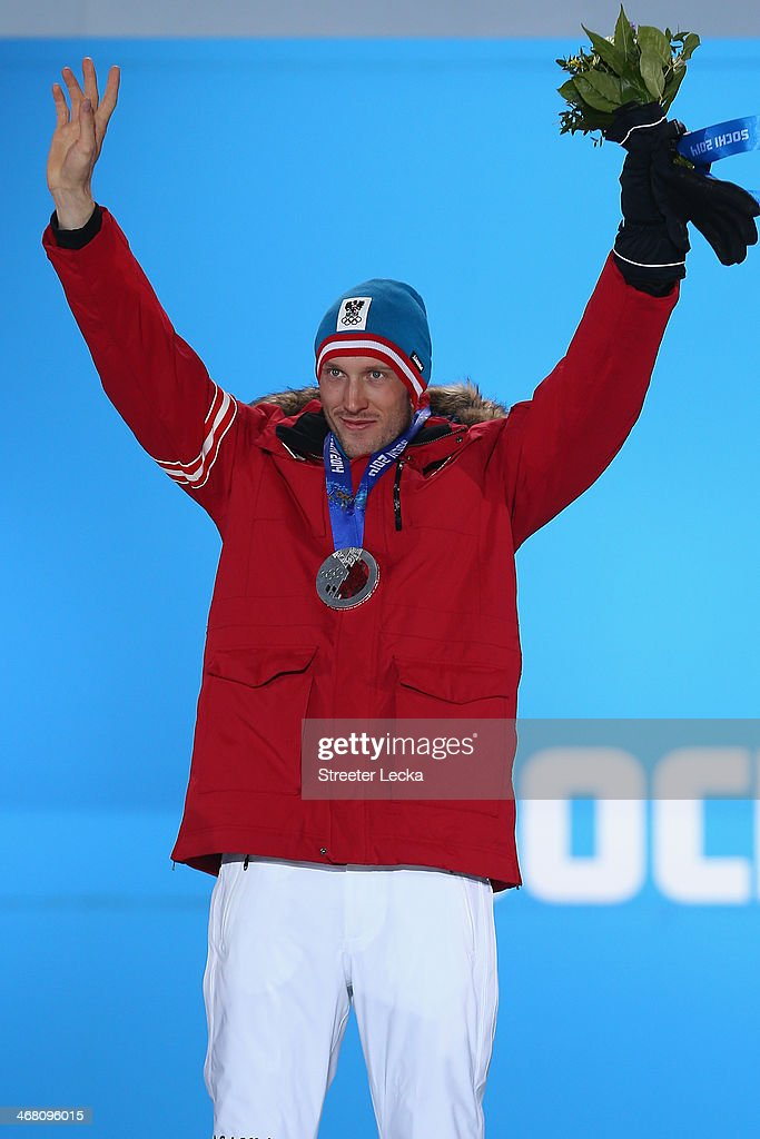 Silver medalist <a gi-track='captionPersonalityLinkClicked' href=/galleries/search?phrase=Dominik+Landertinger&family=editorial&specificpeople=4698843 ng-click='$event.stopPropagation()'>Dominik Landertinger</a> of Austria celebrates during the medal ceremony for the Men's Sprint 10 km on day 2 of the Sochi 2014 Winter Olympics at Medals Plaza on February 9, 2014 in Sochi, .