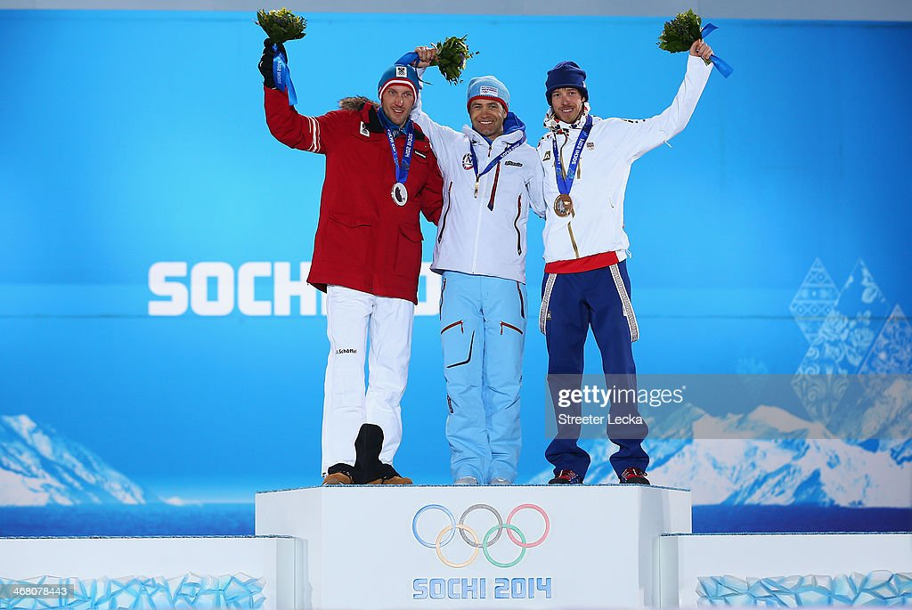 Silver medalist <a gi-track='captionPersonalityLinkClicked' href=/galleries/search?phrase=Dominik+Landertinger&family=editorial&specificpeople=4698843 ng-click='$event.stopPropagation()'>Dominik Landertinger</a> of Austria, gold medalist <a gi-track='captionPersonalityLinkClicked' href=/galleries/search?phrase=Ole+Einar+Bjoerndalen&family=editorial&specificpeople=206663 ng-click='$event.stopPropagation()'>Ole Einar Bjoerndalen</a> of Norway and bronze medalist Jaroslav Soukup of the Czech Republic celebrate on the podium during the medal ceremony for the Men's Sprint 10 km on day 2 of the Sochi 2014 Winter Olympics at Medals Plaza on February 9, 2014 in Sochi, .