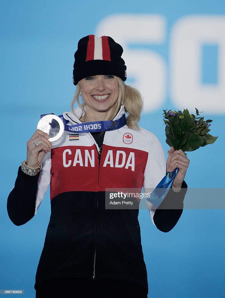 Silver medalist Dominique Maltais of Canada celebrates on the podium during the medal ceremony for the Women's Snowboard Cross on day 9 of the Sochi 2014 Winter Olympics at Medals Plaza on February 16, 2014 in Sochi, Russia.