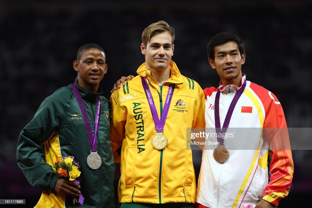 Silver medalist Dyan Buis of South Africa, Gold medaslit Evan O'Hanlon of Australia and bronze medalist Wenjun Zhou of China pose on the podium during the medal ceremony for the Men's 100m - T38 on day 3 of the London 2012 Paralympic Games at Olympic Stadium on September 1, 2012 in London, England.