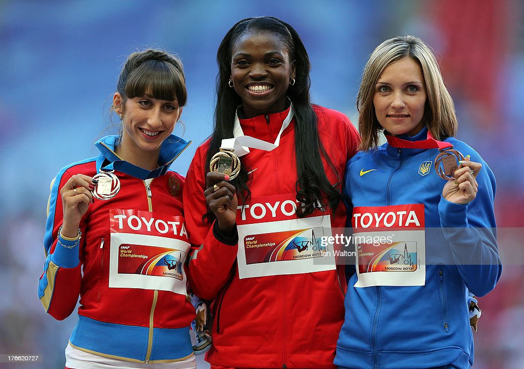 Silver medalist Ekaterina Koneva of Russia, gold medalist <a gi-track='captionPersonalityLinkClicked' href=/galleries/search?phrase=Caterine+Ibarguen&family=editorial&specificpeople=4014993 ng-click='$event.stopPropagation()'>Caterine Ibarguen</a> of Colombia and bronze medalist Olha Saladuha of Ukraine stand on the podium during the medal ceremony for the Women's Triple Jump during Day Seven of the 14th IAAF World Athletics Championships Moscow 2013 at Luzhniki Stadium at Luzhniki Stadium on August 16, 2013 in Moscow, Russia.