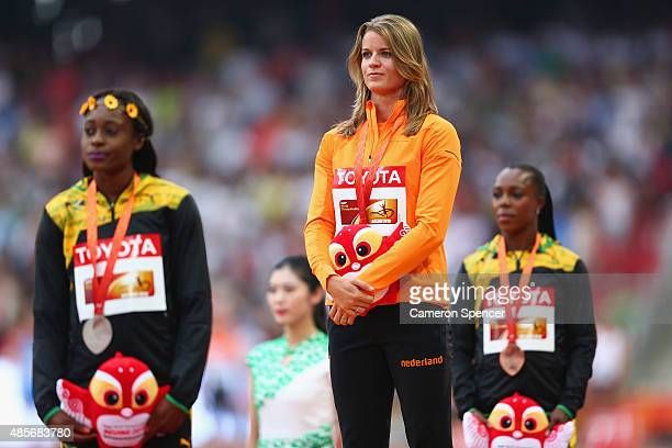 Silver medalist Elaine Thompson of Jamaica gold medalist Dafne Schippers of the Netherlands and bronze medalist Veronica CampbellBrown of Jamaica...