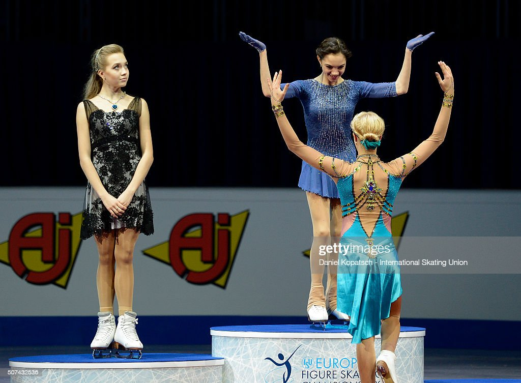 Silver medalist <a gi-track='captionPersonalityLinkClicked' href=/galleries/search?phrase=Elena+Radionova&family=editorial&specificpeople=10056190 ng-click='$event.stopPropagation()'>Elena Radionova</a> of Russia (L-R), gold medalist Evgenia Medvedeva of Russia and bronze medalist <a gi-track='captionPersonalityLinkClicked' href=/galleries/search?phrase=Anna+Pogorilaya&family=editorial&specificpeople=10062042 ng-click='$event.stopPropagation()'>Anna Pogorilaya</a> of Russia react during the medal ceremony of Ladies Free Skating during day three of the ISU European Figure Skating Championships 2016 on January 29, 2016 in Bratislava, Slovakia.