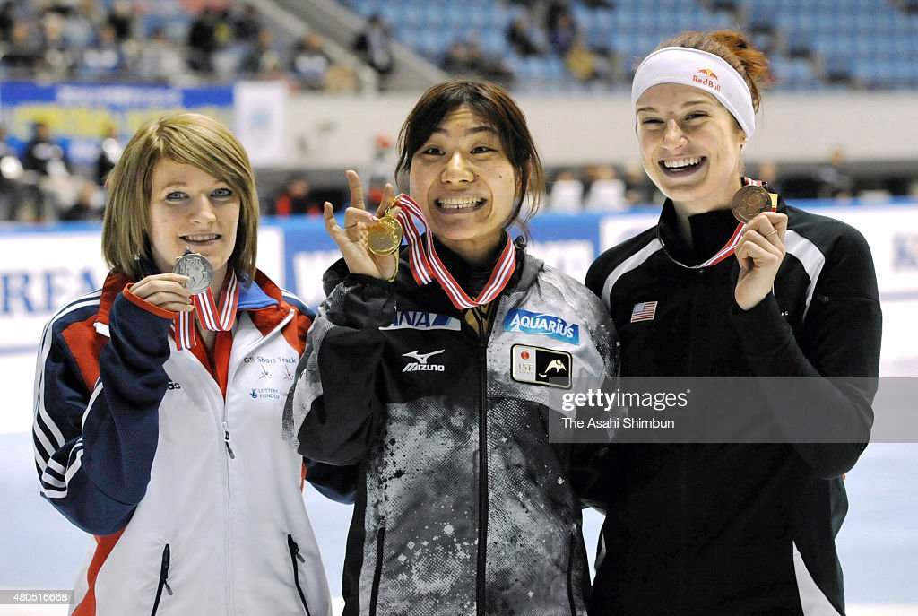 Silver medalist <a gi-track='captionPersonalityLinkClicked' href=/galleries/search?phrase=Elise+Christie&family=editorial&specificpeople=4113885 ng-click='$event.stopPropagation()'>Elise Christie</a> of Great Britain, gold medalist <a gi-track='captionPersonalityLinkClicked' href=/galleries/search?phrase=Yui+Sakai&family=editorial&specificpeople=6521438 ng-click='$event.stopPropagation()'>Yui Sakai</a> and bronze medalist <a gi-track='captionPersonalityLinkClicked' href=/galleries/search?phrase=Katherine+Reutter&family=editorial&specificpeople=4876133 ng-click='$event.stopPropagation()'>Katherine Reutter</a> of the United States pose on the podium at the medal ceremony for Women's 1000m during day three of the ISU Short Track Speed Skating World Cup at Nippon Gaishi Arena on December 3, 2011 in Nagoya, Aichi, Japan.