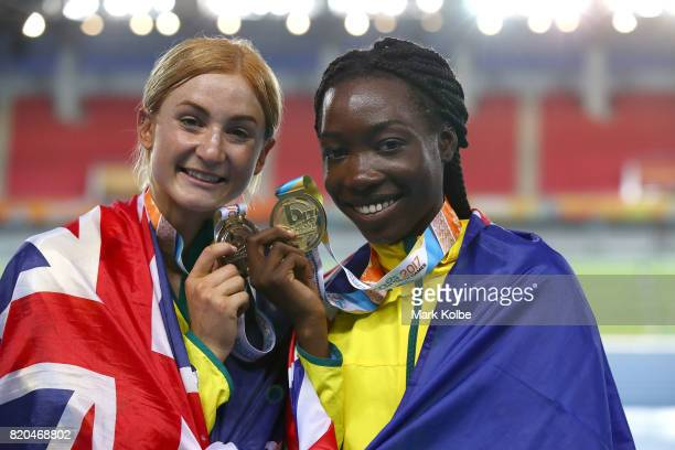 Silver medalist Ella Connolly of Australia and gold medalist Bendere Oboya of Australia pose after the medal ceremony for Girls 400m Final on day 4...