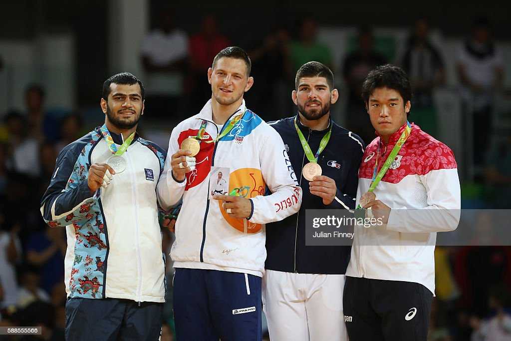 Silver medalist Elmar Gasimov of Azerbaijan gold medalist Lukas Krpalek of the Czech Republic and bronze medalists Cyrille Maret of France and...