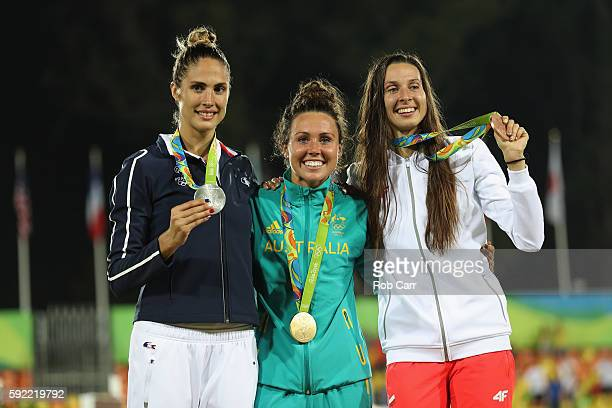 Silver medalist Elodie Clouvel of France gold medalist Chloe Esposito of Australia and bronze medalist Oktawia Nowacka of Poland pose on the podium...