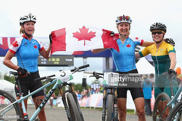 Silver medalist Emily Batty of Canada gold medalist Catharine Pendrel of Canada and bronze medalist Rebecca Henderson of Australia pose as they...