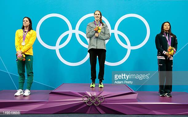 Silver medalist Emily Seebohm of Australia gold medalist Missy Franklin of the UNited States and bronze medalist Aya Terakawa of Japan celebrate on...