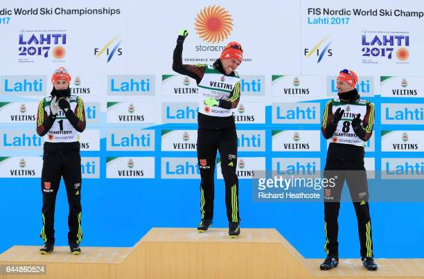Silver medalist Eric Frenzel of Germany gold medalist Johannes Rydzek of Germany and bronze medalist Bjoern Kircheisen of Germany celebrate following...