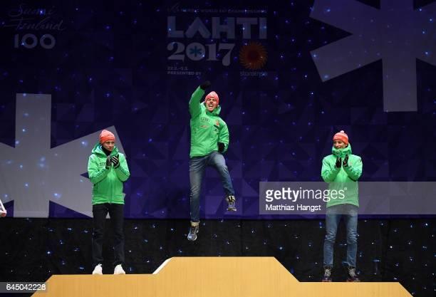 Silver medalist Eric Frenzel of Germany gold medalist Johannes Rydzek of Germany and bronze medalist Bjoern Kircheisen of Germany celebrate during...