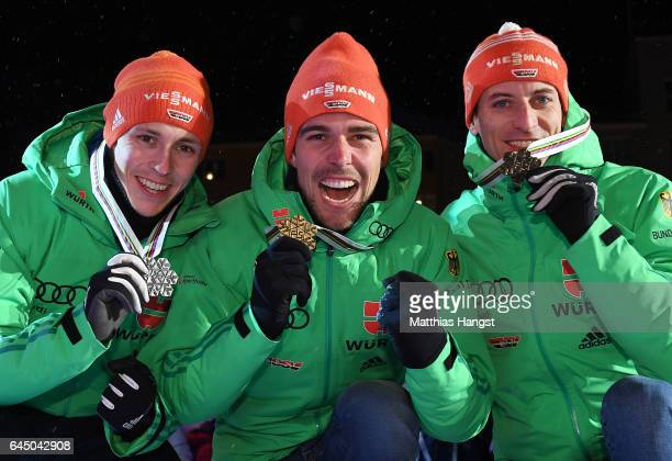 Silver medalist Eric Frenzel of Germany gold medalist Johannes Rydzek of Germany and bronze medalist Bjoern Kircheisen of Germany pose with their...