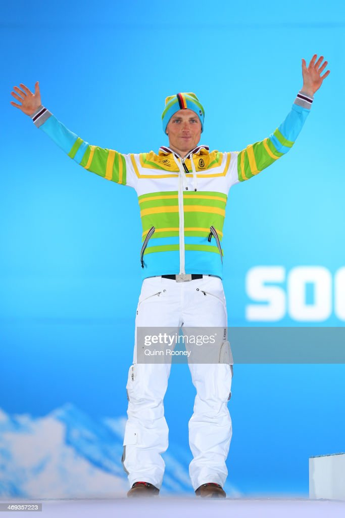 Silver medalist <a gi-track='captionPersonalityLinkClicked' href=/galleries/search?phrase=Erik+Lesser&family=editorial&specificpeople=6837118 ng-click='$event.stopPropagation()'>Erik Lesser</a> of Germany celebrates during the medal for the Men's Individual 20 km on day 7 of the Sochi 2014 Winter Olympics at Medals Plaza on February 14, 2014 in Sochi, Russia.