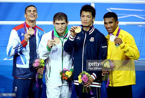 Silver medalist Esquiva Falcao Florentino of Brazil gold medalist Ryota Murata of Japan bronze medalist Abbos Atoev of Uzbekistan and bronze medalist...