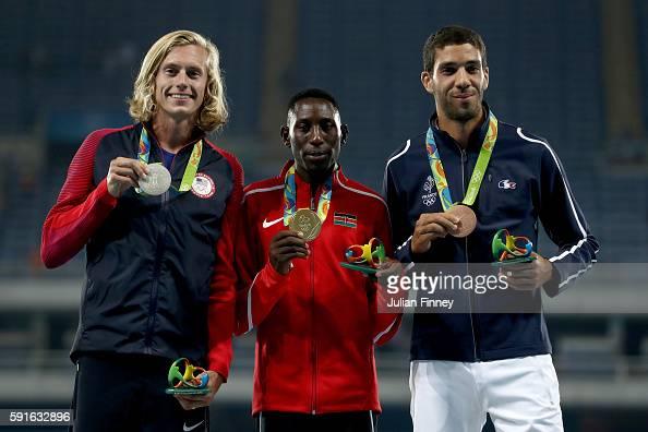 Silver medalist Evan Jager of the United States gold medalist Conseslus Kipruto of Kenya and bronze medalist Mahiedine Mekhissi of France pose on the...