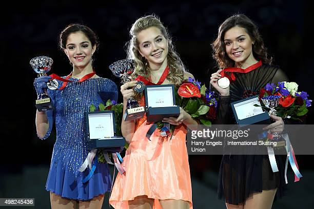 Silver medalist Evgenia Medvedeva of Russia Gold medalist Elena Radionova of Russia and Bronze medalist Adelina Sotnikova of Russia pose with their...