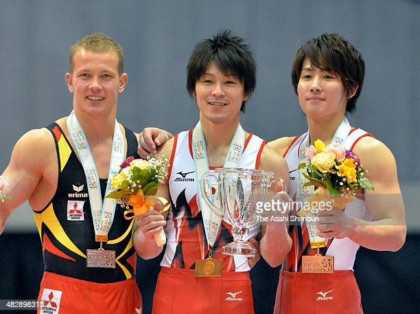 Silver medalist Fabian Hambuechen of Germany gold medalist Kohei Uchimura of Japan and bronze medalist Ryohei Kato of Japan pose for photographs on...