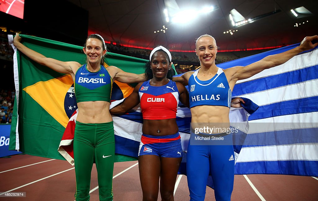 Silver medalist <a gi-track='captionPersonalityLinkClicked' href=/galleries/search?phrase=Fabiana+Murer&family=editorial&specificpeople=834323 ng-click='$event.stopPropagation()'>Fabiana Murer</a> of Brazil, gold medalist <a gi-track='captionPersonalityLinkClicked' href=/galleries/search?phrase=Yarisley+Silva&family=editorial&specificpeople=4425121 ng-click='$event.stopPropagation()'>Yarisley Silva</a> of Cuba and bronze medalist Nikoleta Kyriakopoulou of Greece celebrate after the Women's Pole Vault final during day five of the 15th IAAF World Athletics Championships Beijing 2015 at Beijing National Stadium on August 26, 2015 in Beijing, China.