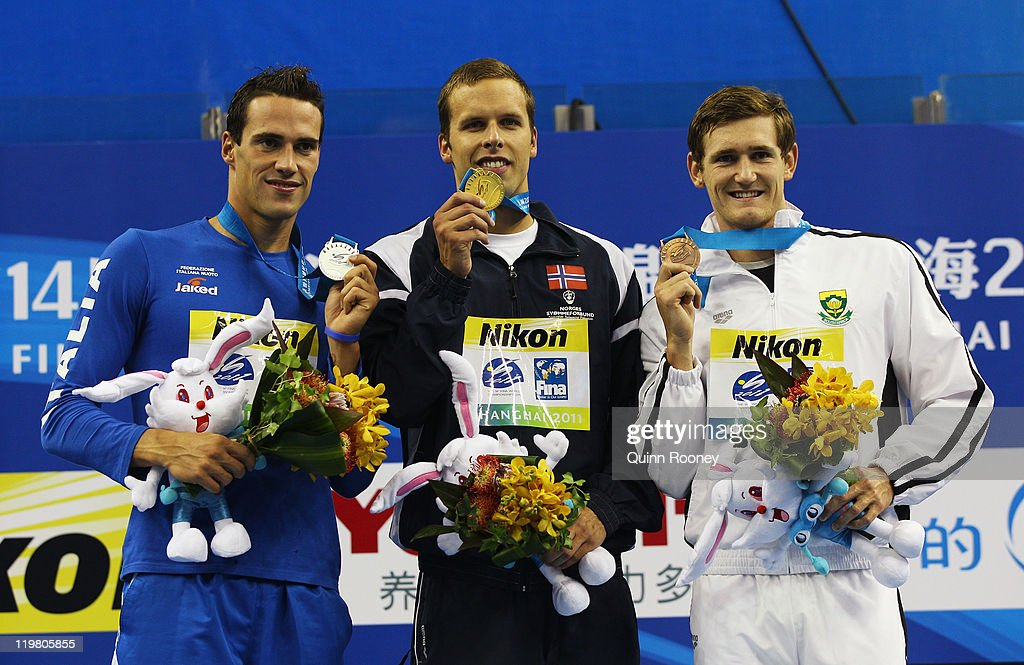 Silver medalist Fabio Scozzoli of Italy, gold medalist <a gi-track='captionPersonalityLinkClicked' href=/galleries/search?phrase=Alexander+Dale+Oen&family=editorial&specificpeople=2090176 ng-click='$event.stopPropagation()'>Alexander Dale Oen</a> of Norway and bronze medalist <a gi-track='captionPersonalityLinkClicked' href=/galleries/search?phrase=Cameron+Van+Der+Burgh&family=editorial&specificpeople=4213103 ng-click='$event.stopPropagation()'>Cameron Van Der Burgh</a> of South Africa pose for a photo on the podium during the medal ceremony for the Men's 100m Breaststroke final during Day Ten of the 14th FINA World Championships at the Oriental Sports Center on July 25, 2011 in Shanghai, China.
