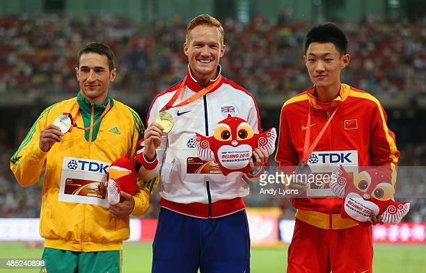 Silver medalist Fabrice Lapierre of Australia gold medalist Greg Rutherford of Great Britain and bronze medalist Jianan Wang of China pose on the...