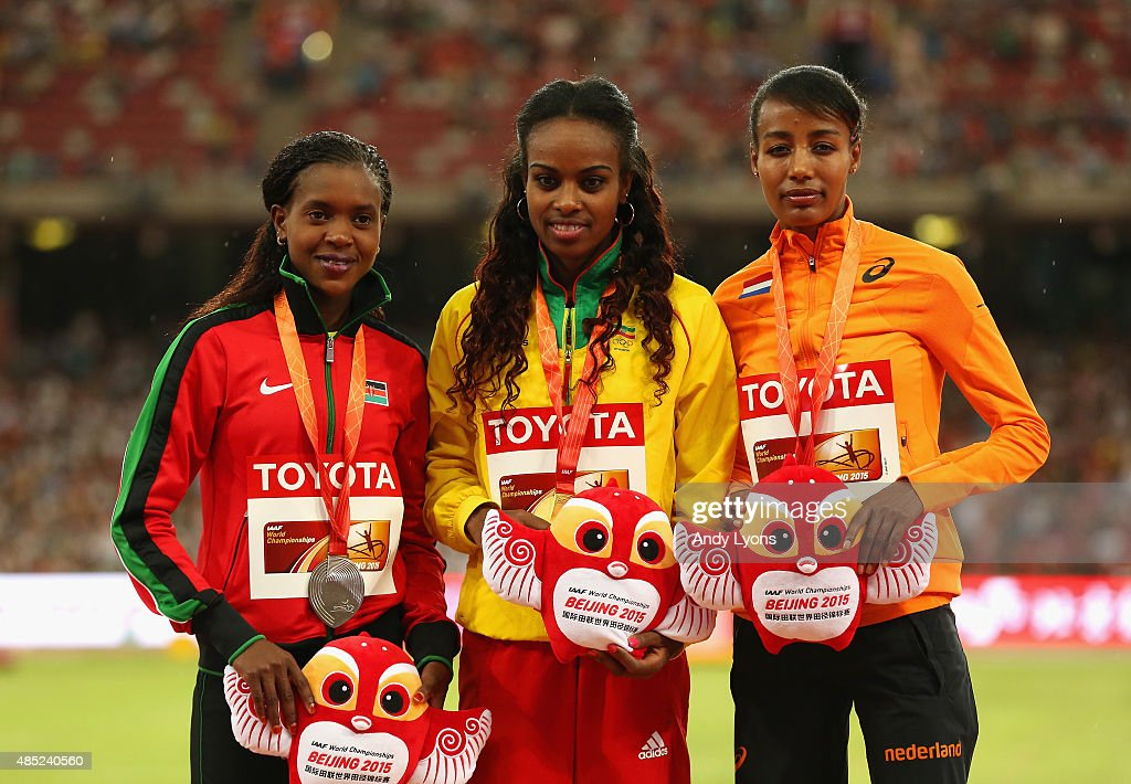 Silver medalist Faith Chepngetich Kipyegon of Kenya, gold medalist <a gi-track='captionPersonalityLinkClicked' href=/galleries/search?phrase=Genzebe+Dibaba&family=editorial&specificpeople=5083525 ng-click='$event.stopPropagation()'>Genzebe Dibaba</a> of Ethiopia and bronze medalist <a gi-track='captionPersonalityLinkClicked' href=/galleries/search?phrase=Sifan+Hassan&family=editorial&specificpeople=10509853 ng-click='$event.stopPropagation()'>Sifan Hassan</a> of the Netherlands pose on the podium during the medal ceremony for the Women's 1500 metres final during day five of the 15th IAAF World Athletics Championships Beijing 2015 at Beijing National Stadium on August 26, 2015 in Beijing, China.