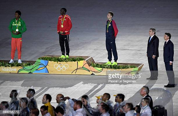 Silver medalist Feyisa Lilesa of Ethiopia gold medalist Eliud Kipchoge of Kenya and bronze medalist Galen Rupp of the United States stand on the...
