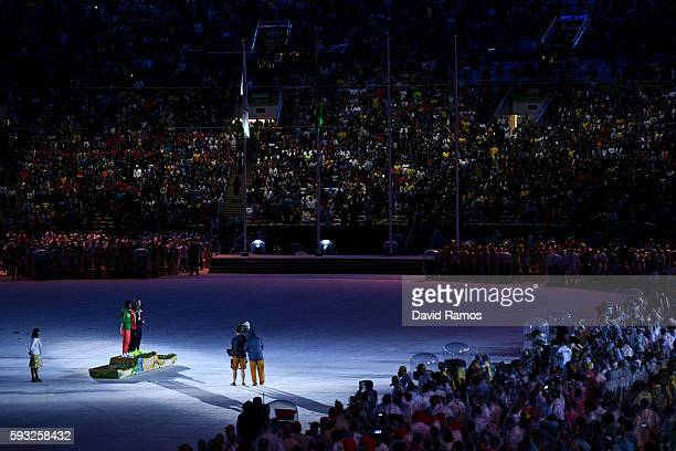 Silver medalist Feyisa Lilesa of Ethiopia gold medalist Eliud Kipchoge of Kenya and bronze medalist Galen Rupp of the United States stand during the...