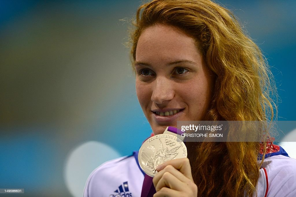 Silver medalist France's Camille Muffat celebrates on the podium of the women's 200m freestyle final during the swimming event at the London 2012...