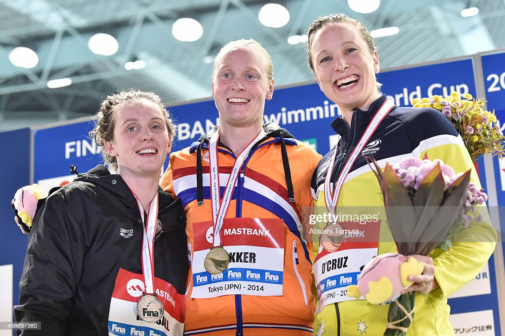 Silver Medalist <a gi-track='captionPersonalityLinkClicked' href=/galleries/search?phrase=Francesca+Halsall&family=editorial&specificpeople=1295778 ng-click='$event.stopPropagation()'>Francesca Halsall</a> of Great Britain, Gold Medalist <a gi-track='captionPersonalityLinkClicked' href=/galleries/search?phrase=Inge+Dekker&family=editorial&specificpeople=201164 ng-click='$event.stopPropagation()'>Inge Dekker</a> of Netherlands and Bronze Medalist Marieke D'cruze of Australia celebrate on the podium after the Women's 50m Butterfly final during FINA/MASTBANK Swimming World Cup 2014 at Tokyo Tatsumi International Swimming Pool on October 29, 2014 in Tokyo, Japan.