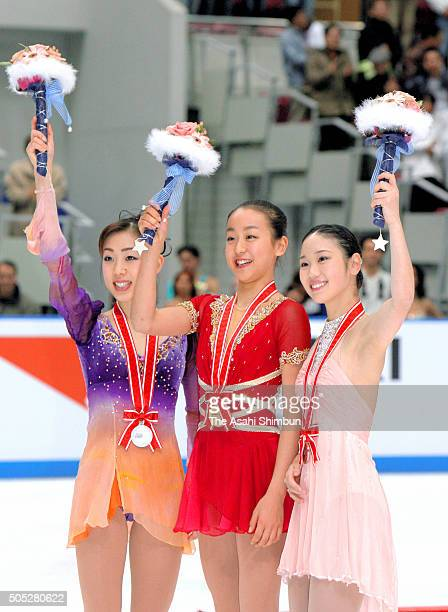 Silver medalist Fumie Suguri gold medalist Mao Asada and bronze medalist Yukari Nakano of Japan celebrate on the podium at the medal ceremony for the...