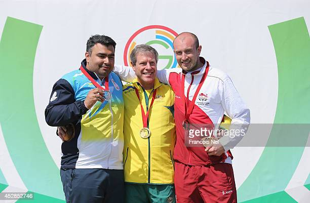 Silver Medalist Gagan Narang of IndiaGold Medalist Warren Potent of Australia and Bronze Medalist Kenneth Parr of England celebrate on the podium...