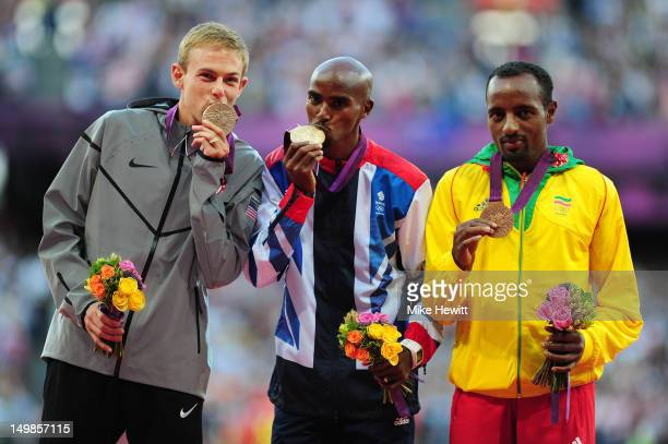Silver medalist Galen Rupp of the United States gold medalist Mohamed Farah of Great Britain and bronze medalist Tariku Bekele of Ethiopia pose on...