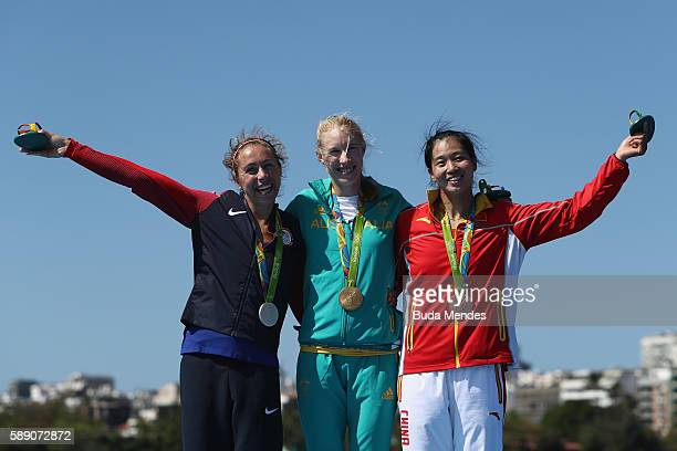 Silver medalist Genevra Stone of the United States gold medalist Kimberley Brennan of Australia and bronze medalist Jingli Duan of China pose on the...