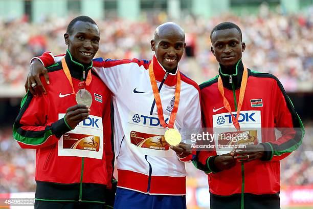 Silver medalist Geoffrey Kipsang Kamworor of Kenya gold medalist Mohamed Farah of Great Britain and bronze medalist Paul Kipngetich Tanui of Kenya...
