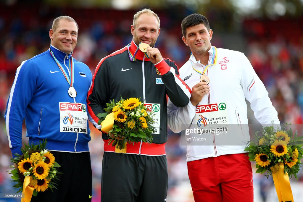 Silver medalist <a gi-track='captionPersonalityLinkClicked' href=/galleries/search?phrase=Gerd+Kanter&family=editorial&specificpeople=1727093 ng-click='$event.stopPropagation()'>Gerd Kanter</a> of Estonia, gold medalist <a gi-track='captionPersonalityLinkClicked' href=/galleries/search?phrase=Robert+Harting&family=editorial&specificpeople=4454412 ng-click='$event.stopPropagation()'>Robert Harting</a> of Germany and bronze medalist Robert Urbanek of Poland stand on the podium during the medal ceremony for the Men's Discus during day three of the 22nd European Athletics Championships at Stadium Letzigrund on August 14, 2014 in Zurich, Switzerland.