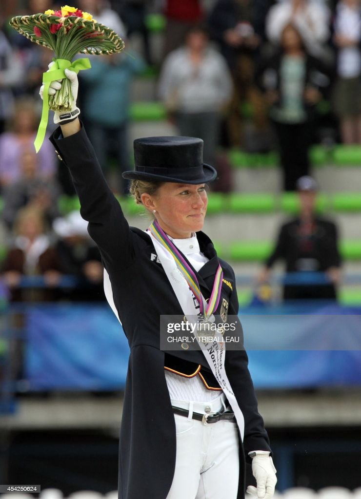 Silver medalist German Helen Langehanenberg poses on the podium during the medals ceremony of the Individual Dressage Grand Prix of the 2014 FEI World Equestrian Games at D'Ornano Stadium in the northwestern French city of Caen on August 27, 2014.