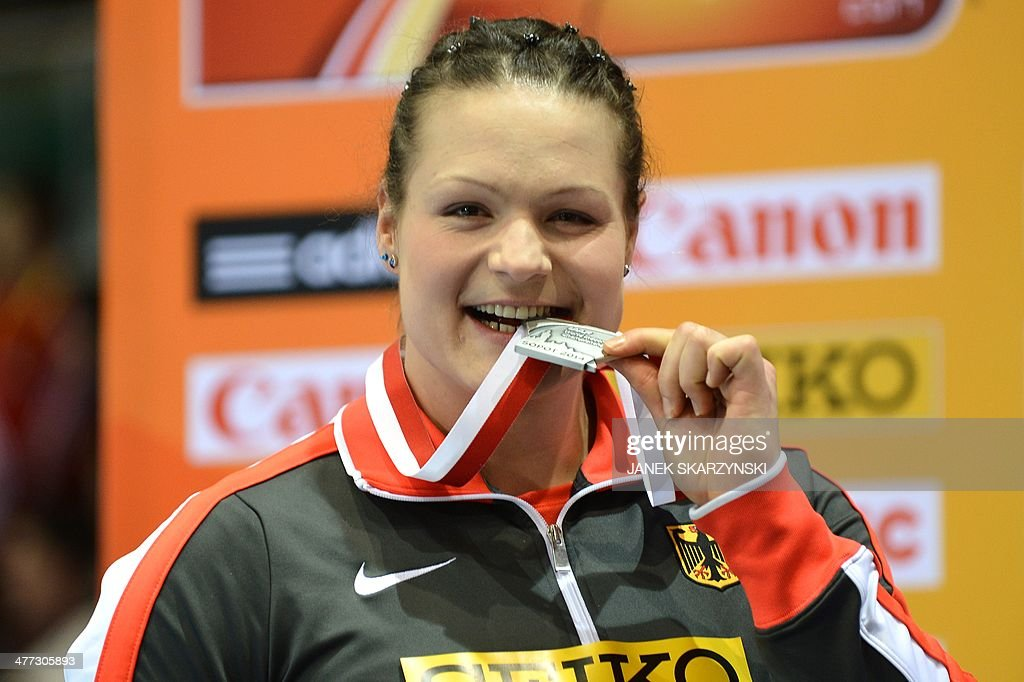 Silver medalist Germany's <a gi-track='captionPersonalityLinkClicked' href=/galleries/search?phrase=Christina+Schwanitz&family=editorial&specificpeople=2287569 ng-click='$event.stopPropagation()'>Christina Schwanitz</a>, kisses her medal on the podium after the Women Shot Put Final event at the IAAF World Indoor Athletics Championships in the Ergo Arena in the Polish coastal town of Sopot, on March 8, 2014.