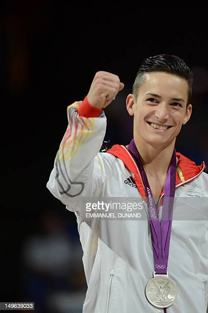 Silver medalist Germany's Marcel Nguyen celebrates on the podium of the men's individual allaround competition of the artistic gymnastics event of...