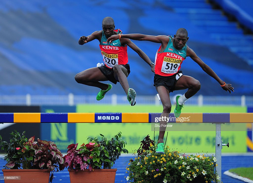 Silver medalist Gilbert Kiplangat Kirui (l) and Gold medalist Conseslus Kipruto of Kenya clear the water jump during the Boys 2000 metres steeplchase final during day three of the IAAF World Youth Championships at Lille Metropole stadium on July 8, 2011 in Lille, France.