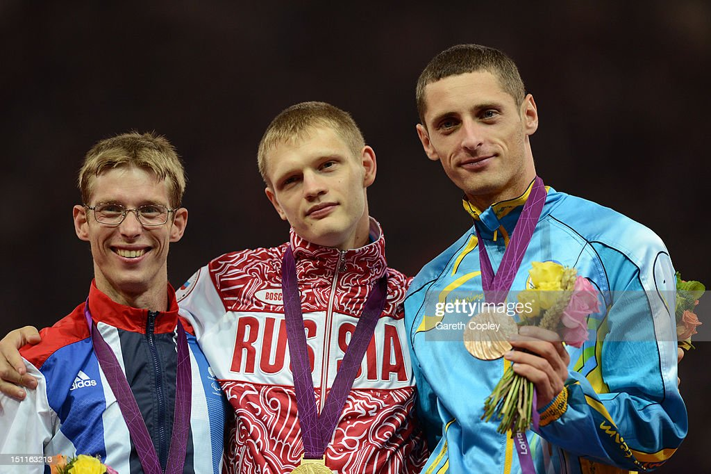 Silver medalist Graeme Ballard of Great Britain, gold medalist Evgenii Shvetcov of Russia and bronze medalist Roman Pavlyk of Ukraine pose on the podium during the medal ceremony for the Men's 100m - T36 Final on day 4 of the London 2012 Paralympic Games at Olympic Stadium on September 2, 2012 in London, England.