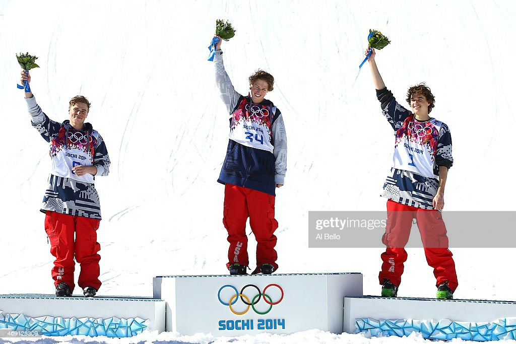 Silver medalist <a gi-track='captionPersonalityLinkClicked' href=/galleries/search?phrase=Gus+Kenworthy&family=editorial&specificpeople=6164869 ng-click='$event.stopPropagation()'>Gus Kenworthy</a> of the United States, gold medalist <a gi-track='captionPersonalityLinkClicked' href=/galleries/search?phrase=Joss+Christensen&family=editorial&specificpeople=7454278 ng-click='$event.stopPropagation()'>Joss Christensen</a> of the United States and bronze medalist Nicholas Goepper of the United States stand on the podium during the flower ceremony after the Freestyle Skiing Men's Ski Slopestyle Finals during day six of the Sochi 2014 Winter Olympics at Rosa Khutor Extreme Park on February 13, 2014 in Sochi, Russia.