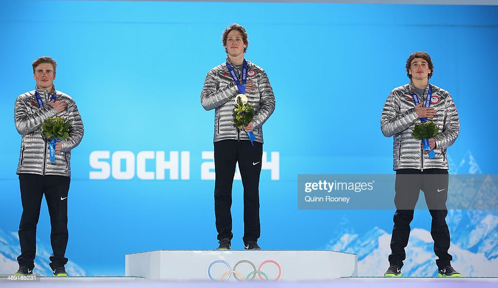 Silver medalist <a gi-track='captionPersonalityLinkClicked' href=/galleries/search?phrase=Gus+Kenworthy&family=editorial&specificpeople=6164869 ng-click='$event.stopPropagation()'>Gus Kenworthy</a> of the United States, gold medalist <a gi-track='captionPersonalityLinkClicked' href=/galleries/search?phrase=Joss+Christensen&family=editorial&specificpeople=7454278 ng-click='$event.stopPropagation()'>Joss Christensen</a> of the United States and bronze medalist Nicholas Goepper of the United States pose during the National Anthem during the medal ceremony for the Freestyle Skiing Men's Ski Slopestyle on day six of the Sochi 2014 Winter Olympics at Medals Plaza on February 13, 2014 in Sochi, Russia.