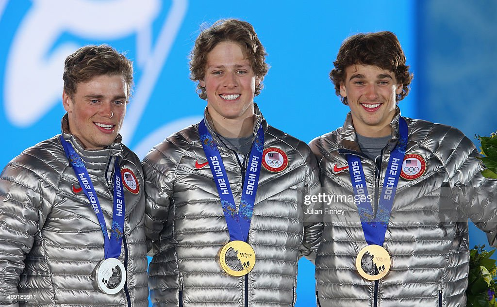 Silver medalist Gus Kenworthy of the United States, gold medalist Joss Christensen of the United States and bronze medalist Nicholas Goepper of the United States celebrates during the medal ceremony for the Freestyle Skiing Men's Ski Slopestyle on day six of the Sochi 2014 Winter Olympics at Medals Plaza on February 13, 2014 in Sochi, Russia.