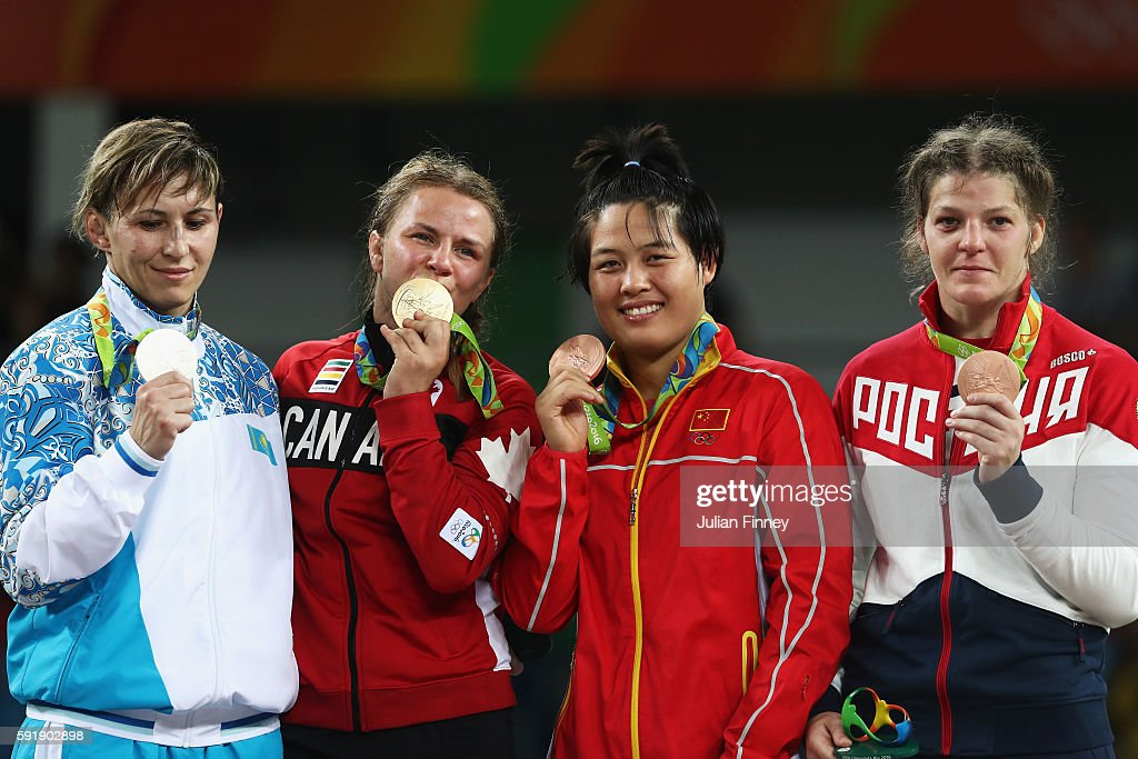 Silver medalist Guzel Manyurova of Kazakhstan, gold medalist Erica Elizabeth Wiebe of Canada, bronze medalist Fengliu Zhang of China and bronze medalist Ekaterina Bukina of Russia stand on the podium during the medal ceremony following the Women's Freestyle 75 kg competition on Day 13 of the Rio 2016 Olympic Games at Carioca Arena 2 on August 18, 2016 in Rio de Janeiro, Brazil.