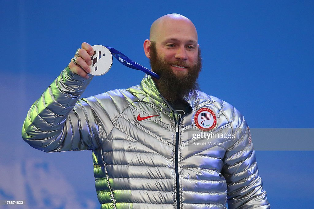 Silver medalist Heath Calhoun of the United States celebrates at the medal ceremony for men's Super Combined Sitting on day eight of the Sochi 2014 Paralympic Winter Games at Laura Cross-country Ski & Biathlon Center on March 15, 2014 in Sochi, Russia.