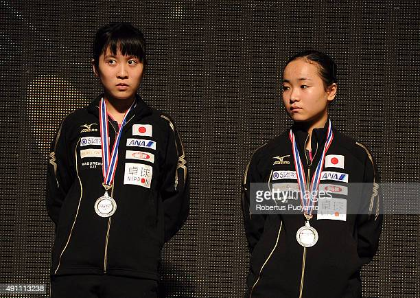 Silver medalist Hirano Miu and Ito Mima of Japan celebrate on the podium during Women's doubles awarding ceremony of the 22nd 2015 ITTF Asian Table...