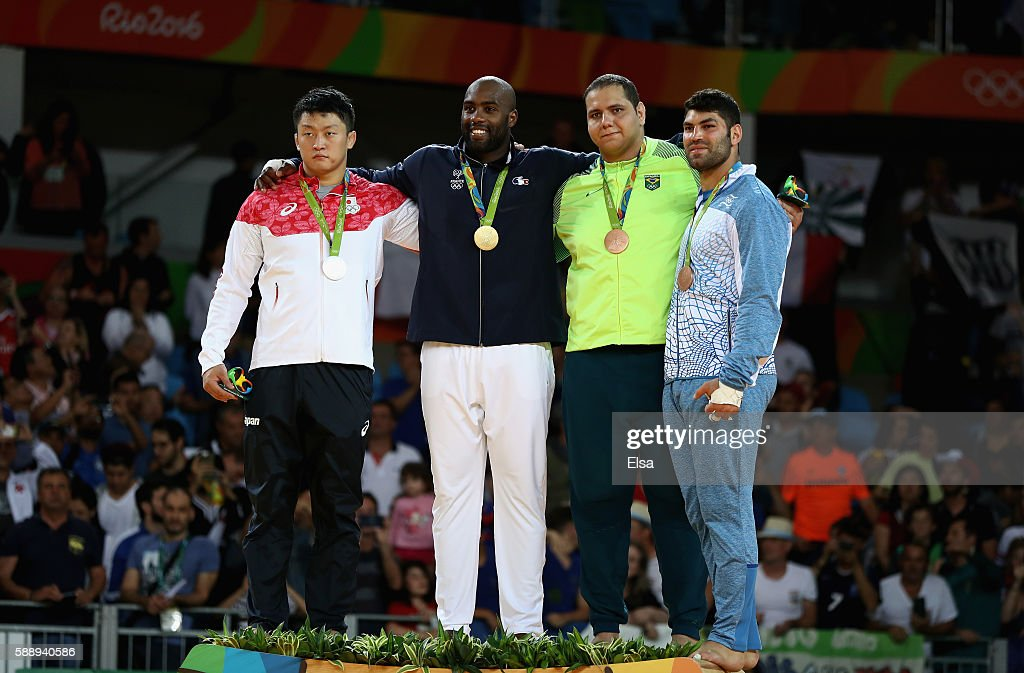 Silver medalist Hisayoshi Harasawa of Japan gold medalist Teddy Riner of France and bronze medalists Rafael Silva of Brazil and Or Sasson of Israel...