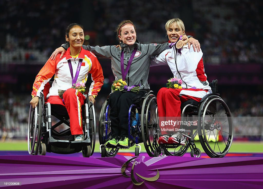 Silver medalist Hongjiao Dong of China, Gold medalist Tatyana Mcfadden of the United States and bronze medalist Edith Wolf of Switzerland pose on the podium during the medal ceremony for the Women's 400m - T54 Final on day 5 of the London 2012 Paralympic Games at Olympic Stadium on September 3, 2012 in London, England.